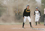 CHAD PILSTER &middot; Hays Daily News<br /> <br /> Fort Hays State University's Adara Erickson (10) slides in to score the winning run as Katlyn Kern (12) celebrates on Friday, April 5, 2013, at Tiger Stadium at Fort Hays State University in Hays, Kansas. Fort Hays State University beat Missouri Western State University in the first game of a double header 12 innings 2-1.