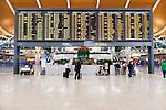 Departure board at Shanghai Pudong International Airport, China