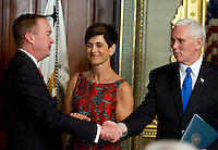 United States Vice President Mike Pence, right, shakes hands with former US Representative Mick Mulvaney (Republican of South Carolina), left, after he was sworn-in to be Director of the Office of Management and Budget (OMB) in the Vice President's Ceremonial Office at the White House in Washington, DC on Thursday, February 16, 2017. Mulvaney's wife, Pamela West Mulvaney, is at center.<br /> Credit: Ron Sachs / Pool via CNP /MediaPunch
