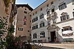 Small plaza with houses, bikes, and the Hotel Palazzo Salis built in 1630 by the knight Battista in Solgio, a town in the Bregaglia Valley that is said to be one of the most picturesque towns in Switzerland