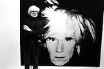 Andy Warhol with self portrait, London.