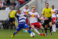 David Ferreira (10) of FC Dallas and Dax McCarty (11) of the New York Red Bulls during a Major League Soccer (MLS) match at Red Bull Arena in Harrison, NJ, on September 22, 2013.