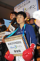 March 22, 2011, Kawasaki City, Kanagawa Prefecture, Japan - Local junior athletes pitch in to gather donations for earthquake, tsunami and fire survivors of the 2011 Tohoku-Kanto Natural Disaster in front of Mizonokuchi Station in Kawasaki, Kanagawa Prefecture, Japan.  (Photo by Atsushi Tomura/AFLO)