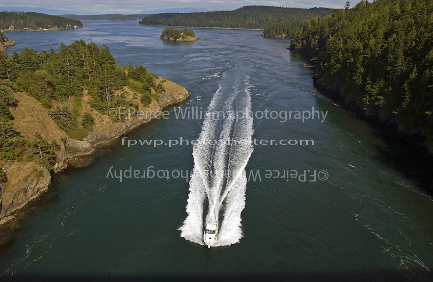 A boat motors through Deception Pass.