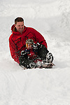 California, Lake Tahoe: Child and father enjoy snow play with sled at North Lake Tahoe Regional Park.  Photo copyright Lee Foster.  Photo # cataho107634