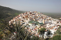 View of the town of Moulay Idriss, over rooftops with the Mausoleum of Moulay Idriss I in the foreground, Meknes-Tafilalet, Northern Morocco. The town sits atop 2 hills on Mount Zerhoun and was founded by Moulay Idriss I, who arrived in 789 AD and ruled until 791, bringing Islam to Morocco and founding the Idrisid Dynasty. It is an important pilgrimage site for muslims. Picture by Manuel Cohen