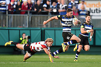 Matt Banahan of Bath Rugby gets past Billy Twelvetrees of Gloucester Rugby. West Country Challenge Cup match, between Bath Rugby and Gloucester Rugby on September 26, 2015 at the Recreation Ground in Bath, England. Photo by: Patrick Khachfe / Onside Images