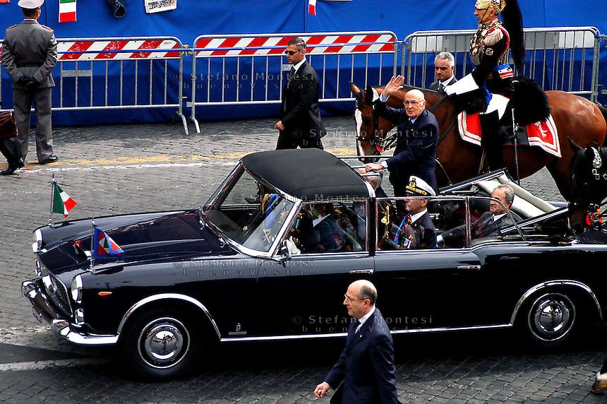 Roma   2 Giugno 2006.Festa della Repubblica (Republic Day).Il Presidente della Repubblica Giorgio Napolitano sulla Lancia Cabriolet Landaulet nera, saluta il pubblico prima della sfilata militare in via Dei Fori Imperiali.