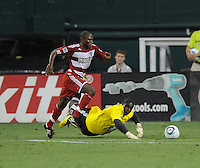 DC United goalkeeper Bill Hamid (28) dives to save the play against FC Dallas Jeff Cunningham (9) with no result.  FC. Dallas defeated DC United 3-1 at RFK Stadium, Saturday August 14, 2010.