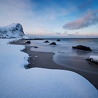 Snow covered Myrland beach in winter, Flakstadøy, Lofoten Islands, Norway