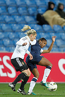 US's Cristal Dunn fights for the ball with Germany's Svenja Huth during their Algarve Women's Cup soccer match at Algarve stadium in Faro, March 13, 2013.  .Paulo Cordeiro/ISI