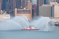 """FDNY fire boat Marine 1 """"Three Forty Three"""" puts on a water show on the Hudson river prior to the annual Macy's Fourth of July fireworks on Wednesday, July 4, 2012.  Fireboat 343 is dedicated to the 343 members of the FDNY who died in the terrorist attacks of September 11, 2001."""