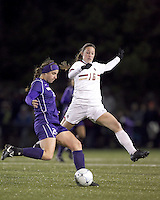 """University of Washington defender Molly Boyd (25) clears the ball as Boston College forward Brooke Knowlton (16) pressures. In overtime, Boston College defeated University of Washington, 1-0, in NCAA tournament """"Elite 8"""" match at Newton Soccer Field, Newton, MA, on November 27, 2010."""