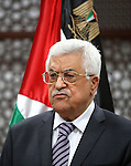 Palestinian President Mahmoud Abbas speaks to journalists during a news conference in his headquarters in the West Bank city of Ramallah July 31, 2015. Suspected Jewish attackers torched a Palestinian home in the occupied West Bank on Friday, killing an 18-month-old toddler and seriously injuring three other family members, an act that Israel's prime minister described as terrorism. Photo by Shadi Hatem