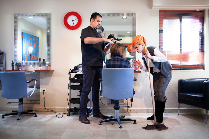 Jan 2013,  Ramallah., West Bank. At the Wella beauty center, located in the business quarter of Ramallah, a woman is preparing herself for her trip to the G8 meeting in Davos, where she is going for networking. While the hair cut is being finished, she receives a call at the standard of the beauty center from her secretary: the hotels are almost all full, and she can only find rooms at 600$. The business women express her wish to remain anonymous, as the fact of being cut her hair by a man could affect her reputation toward her conservative partners.