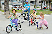 Santa Monica Mayor Richard Bloom with children ride bikes at the new  Bicycle Campus  at Santa Monica Beach on  Earth Day,  Sunday, April 22, 2012..