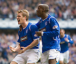 Steven Davis celebrates with DaMarcus Beasley by rocking a baby cradle