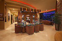 Beautiful wetbar is seen in modern luxury home at night