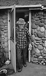 """December 1971:  Modesto, California—Dad Walkling— Walkling heads out to milk his Swiss nanny.  I first met Orlando """"Dad"""" Walkling at his house in the airport district of Modesto just before his 104th birthday.  Walkling was born in Indian Territory January 2, 1868, near a town now called McAlester, Oklahoma.  His mother was Shawnee and his father, whom he didn't remember, was an Englishman named Orlando.  He later used the name Walkling instead of his Indian name of Skipocase.  On September 16, 1893, Skipocase O. Walkling, then 25 years old, was among thousands of settlers who rode into the Cherokee Strip Land Run of Oklahoma to make a free land claim.  Walkling told of how he rode into the 226-mile long """"Strip"""" to claim 160 acres.  """"There were thousands of men who waited at the line until noon that day.  The army gun was fired and chaos broke out. Every man carried a gun. There was no law, no sheriff, nothing.  People had to fight for their claim even though they were first.""""  Walkling made a claim, but later gave it up when he had a chance to farm a piece of land in Noble County, Oklahoma.  He cleared the land with six yoke of oxen and planted peach orchards.  He and his first wife ran a combination grocery store and hotel there.  He had nearly 1,000 trees and began a cannery to process the crops.  """"One day when the train came in a woman dressed like a Salvation Army woman handed me a bundle as I stood on the ramp, then she jumped back into the train.  I opened it and there was a pair of twins, a boy and a girl,"""" Walkling said.  He and his wife did not have children, so they adopted the twins legally and raised them.  He said they raised six others but did not adopt them.  He came to Modesto in 1944 at 76 years of age and went to work for a meat firm before he opened a poultry store.  After that store closed, he made bullwhips and wove rope for truckers at his home.  In 1968, Dad Walking, then 100 years old, visited Oklahoma for the 75th anniversary of t"""