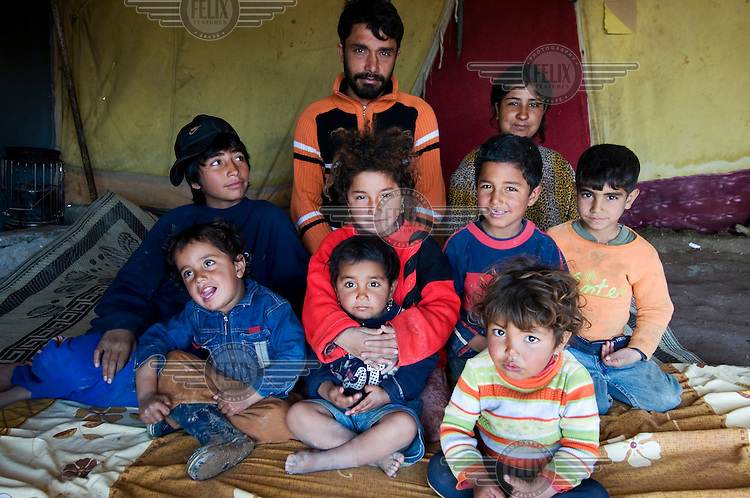 Hadi Abdullah Ali with his family in the Qawala camp for displaced persons, where 136 families from accross the country are housed.