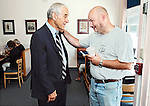 Conway, New Hampshire: July 1, 2011<br /> Presidential candidate Ron Paul (at left) is greeted by a man while campaigning at the Conway Cafe.  This political campaign is Paul's third bid for the presidency. &copy;Chris Fitzgerald / Candidate Photos