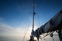 Sailor on mast to keep watch for icebergs while navigating towards Tasiilaq in east Greenland