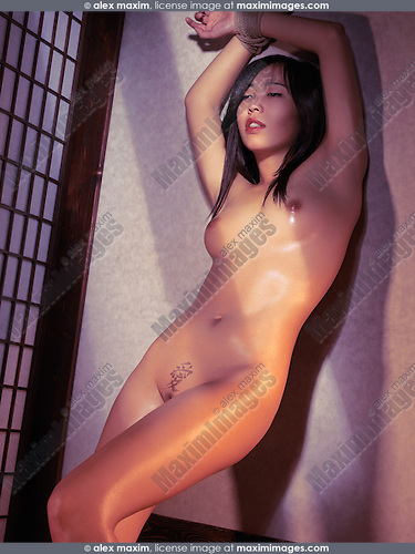 Home Beautiful Asian Woman Standing Naked At A Wall With Tied Hands