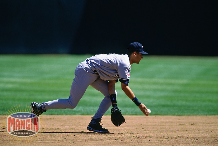 OAKLAND, CA - Derek Jeter of the New York Yankees makes a play at shortstop during a game against the Oakland Athletics at the Oakland Coliseum in Oakland, California on August 26, 1997. (Photo by Brad Mangin)