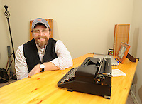NWA Democrat-Gazette/ANDY SHUPE - Jason Kindall is the executive director for Habitat for Humanity of Washington County and his favorite space is the room he uses to write in his Fayetteville home.