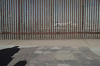 Families are often separated by the border due the deportation. Visit are allowed and controlled by the US government  under strict surveillance through the fence only. Tijuana, Mexico. Jan 04, 2015.