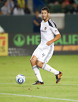 LA Galaxy defender Omar Gonzalez looks to pass during the first half of the game between LA Galaxy and the Seattle Sounders at the Home Depot Center in Carson, CA, on November 7, 2010. LA Galaxy 2, Seattle Sounders 1. LA Galaxy advance in the playoffs with an aggregate score of 3 to 1.