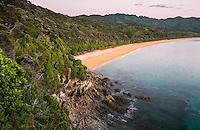 Totaranui beach in pastel colours of twilight before sunrise on Abel Tasman Coast Track, Abel Tasman National Park, Nelson Region, South Island, New Zealand