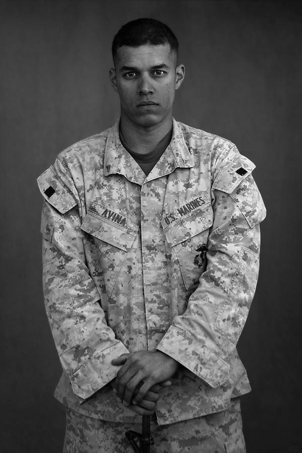 Lcpl. Alexander Avina, 20, Brea, California, Weapons Platoon, Kilo Co. 3rd Battalion 1st Marines, United States Marine Corps, at the company's firm base in Haditha, Iraq on Sunday Oct. 22, 2005.