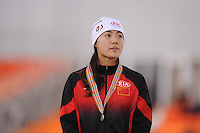 SPEEDSKATING: SOCHI: Adler Arena, 24-03-2013, Essent ISU World Championship Single Distances, Day 4, podium 500m Ladies, Beixing Wang (CHN), © Martin de Jong