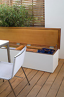 A close-up of the storage boxes and seating area