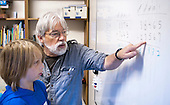 Leonard Turton teaching Maths, Summerhill School, Leiston, Suffolk. The school was founded by A.S.Neill in 1921 and is run on democratic lines with each person, adult or child, having an equal say.  You don't have to go to lessons if you don't want to but could play all day.  It gets above average GCSE exam results.