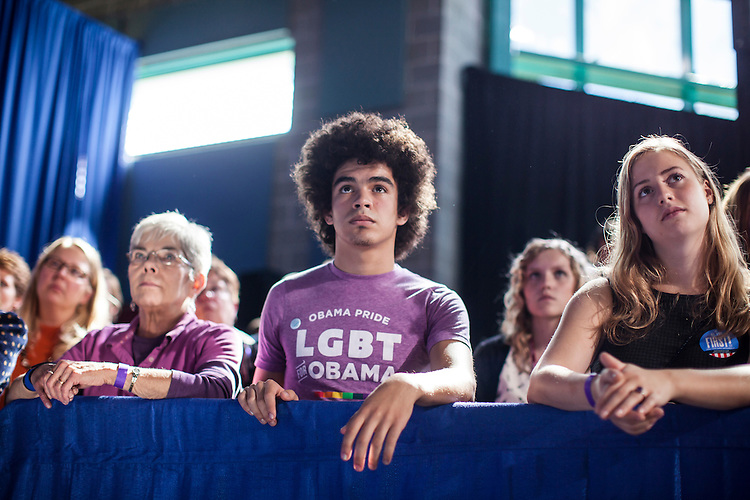 Antonio Montoya, center, an 18-year-old freshman at Grinnell College, listens as Vice President Joe Biden speaks at a rally at Grinnell College during a two-day campaign swing through Iowa on Tuesday, September 18, 2012 in Grinnell, IA.