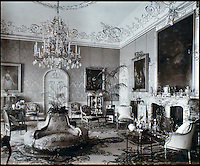 BNPS.co.uk (01202 558833)<br /> Pic: Lawrences/BNPS<br /> <br /> The drawing room at Highclere Castle.<br /> <br /> An intimate set of portraits of the real Downton Abbey which include the visit of the future king have been unearthed after more than 120 years.<br /> <br /> The magnificent 19th century Highclere Castle, in Hampshire, was home to George Herbert, fifth Earl of Carnarvon, and his wife Almina Herbert in the late 19th and early 20th century.<br /> <br /> The album, which is up for auction, contains 44 large mounted photographs of the house, staff and estate of Highclere in 1895.<br /> <br /> Included are images of Carnarvon with his wife Almina, various shooting parties including one involving Prince Edward (the future Edward VII) and the house staff.