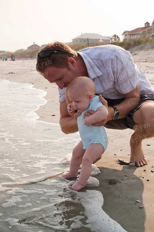 baby girl and dad at the beach