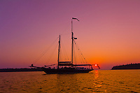 Schooner Nathaniel Bowditch, at sunset, moored in Holbrook Bay (part of Penobscot Bay), Maine USA