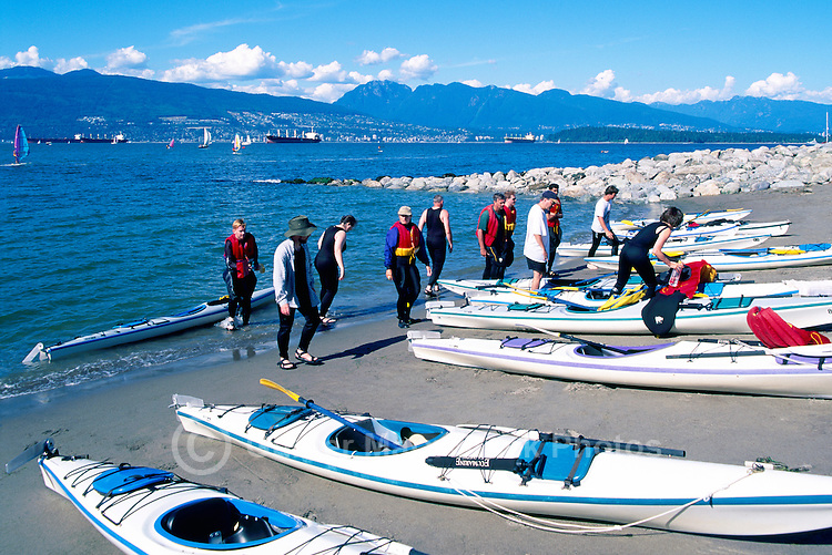 "Vancouver, BC, British Columbia, Canada - Kayakers with Kayaks at Jericho Beach -  English Bay and ""North Shore"" Mountains (Coast Mountains)"