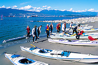 "Vancouver, BC, British Columbia, Canada - Kayakers with Kayaks at Jericho Beach -  English Bay and ""North Shore"" Mountains (Coast Mountains)"