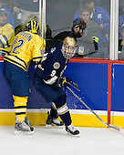 Carl Hagelin (Michigan - 12), Ryan Thang (Notre Dame - 9) - The University of Notre Dame Fighting Irish defeated the University of Michigan Wolverines 5-4 in overtime in their 2008 Frozen Four Semi-Final matchup on Thursday, April 10, 2008, at the Pepsi Center in Denver.