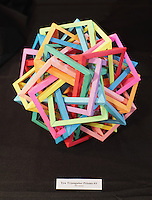 New York, NY, USA - June 22, 2012: Complex modular polyhedron designed and folded out of 90 pieces of paper by Daniel Kwan, from New Jersey, on display at the OrigamiUSA 2012 convention exhibition held at Fashion Institute of Technology in New York City.