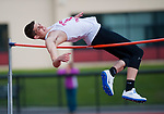 TORRINGTON, CT-051017JS08- Torrington's Bill Cook tries to clear 6'1&quot; while competing in the high jump during their meet Sacred Heart and Wilby Wednesday at Torrington High School. <br /> Jim Shannon Republican-American