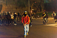 """Roma, 27 Ottobre 2012: .No Monti Day, manifestazione nazionale contro le politiche del  governo .Ungruppo di manifestanti lancia oggetti contro la polizia in viale Castrense.""""No Monti Day"""" protest in Rome against the austerity cuts of the Italian government.."""