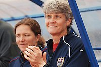 US Coach Pia Sundhage and assistant coach Hege Riise (background) look on the field.  The USWNT defeated Iceland (2-0) at Vila Real Sto. Antonio in their opener of the 2010 Algarve Cup on February 24, 2010.