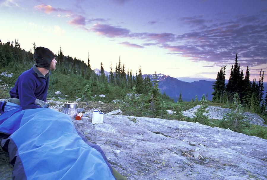 Backpacker in bivy sack, Mount Rainier National Park, Washington