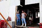 From left, dockworkers Anthony Armand, 53, and Wilmer Mancia, 34, wait for customers at Dean Blanchard Seafood, Inc. in Grand Isle, LA on June 24, 2010 where a fishing ban has been put in place due to the B.P. oil spill. The seafood company once was working 24 hours a day and seven days a week during shrimping season, but has reduced operating hours and mostly sells gas and ice now. The company also laid off almost 80 workers according to owner, Dean Blanchard.
