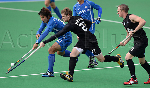 18.05.2013. Auckland, New Zealand.  Korea's Hyun Woo Nam and Stephen Jenness battle for possession during the 3rd Hockey test match. New Zealand Men's Blacks Sticks v Korea. Saturday 18 May 2013. Pukekohe, Auckland.